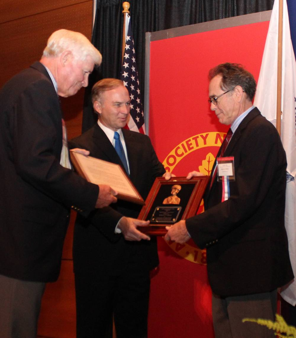 File American Society of Naval Engineers (ASNE) President Ronald Kiss (left) and U.S. Rep. Randy Forbes (Va.) present the Frank C. Jones Award to Bill Clifford (right), president of BAE Systems Ship Repair, at the Fleet Maintenance and Modernization Symposium in Virginia Beach. The award, presented annually by the ASNE, recognizes leaders in naval engineering who have contributed to ship maintenance and alteration programs for naval vessels.