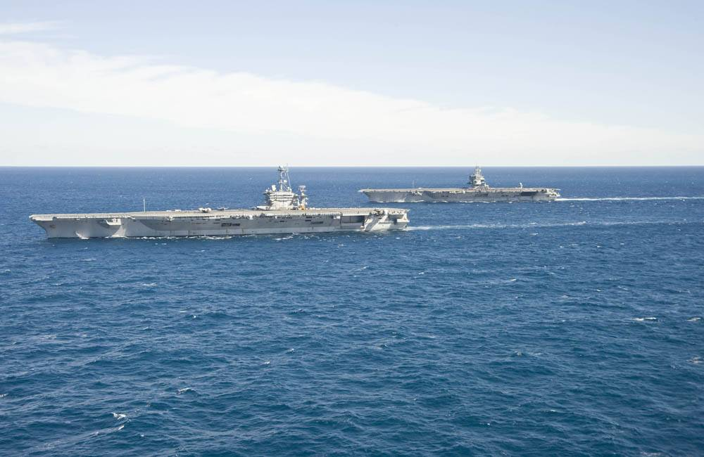 The aircraft carrier USS Enterprise (CVN 65) passes the aircraft carrier USS Harry S. Truman (CVN 75) in the Atlantic Ocean. (U.S. Navy photo by Naval Aircrewman (Tactical Helicopter) 3rd Class Matt Ballard/Released)
