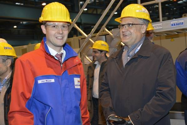 The steel cutting took place at the Meyer Werft shipyard in Papenburg, Germany, where the two ships will be built. Pictured here are (from left to right) Jan Meyer, Managing Partner, Meyer Werft and Harri Kulovaara, EVP, Newbuild and Design, Royal Caribbean International.