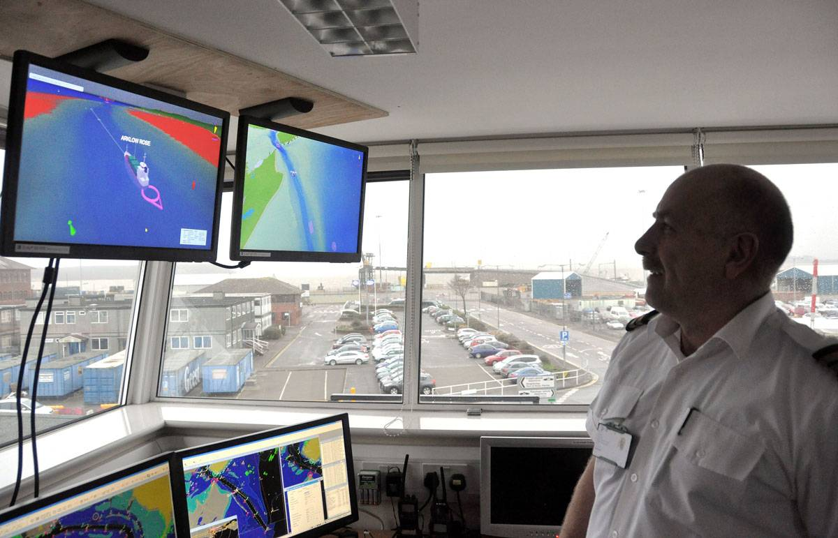 """A Harbour Control Officer using GeoVS' 3D vessel management system in Poole""."