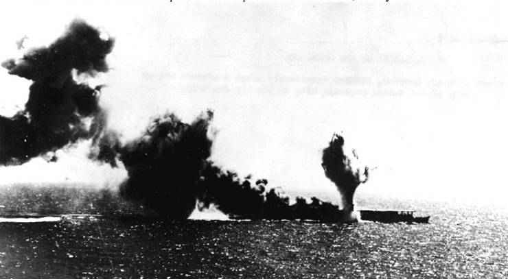Japanese aircraft carrier Shoho is torpedoed, during attacks by U.S. Navy carrier aircraft in the late morning of 7 May 1942. Photographed from a USS Lexington (CV-2) plane. (Official U.S. Navy Photograph, National Archives.)