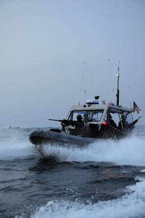 A boat crew from U.S. Coast Guard Port Security Unit (PSU) 313, from Everett, Wash., conducts a security patrol in a 4th generation, 32-foot transportable security boat (TSB) off the coast of Dogu beach in support of exercise Foal Eagle, April 21, 2013. PSU 313 along with Republic of Korea military forces, provided 24-hour water-side and shore-side force protection during Foal Eagle, a Combined/Joint Logistics Over-the-Shore Exercise (C/JLOTS). (U.S. Coast Guard photo by Petty Officer 2nd Class