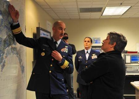 Rear Adm. Thomas Ostebo, commander District 17, explains Coast Guard operations in the Arctic and the distances covered by Coast Guard assets throughout Alaska to Secretary of Homeland Security Janet Napolitano, Monday, Aug. 5, 2012, during a tour of Base Kodiak, Alaska. Napolitano toured Base Kodiak and addressed assembled Coast Guardsmen at Air Station Kodiak while on a visit to several Coast Guard units across the state. U.S. Coast Guard photo by Petty Officer 3rd Class Jonathan Klingenberg.