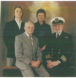 File L-R Roderick Davis, son, Thelma Davis, wife, Reginald Bowker, father in law, Captain Roy Davis