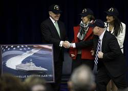 The Secretary of the Navy (SECNAV) the honorable Ray Mabus shakes hands with retired Navy Capt. Mark Kelly, husband of former U.S. Rep. Gabrielle Giffords, from Arizona, at the Pentagon. Mabus announced that the name of the 10th littoral combat ship, LCS 10, will be USS Gabrielle Giffords. (U.S. Navy photo by Chief Mass Communication Specialist Sam Shavers/Released)