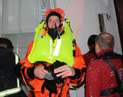 File Gudmunder Bragason of Sónar emerges from Rejkavik harbour covered in ice after the successful Kru lifejacket/ R10 demonstration.