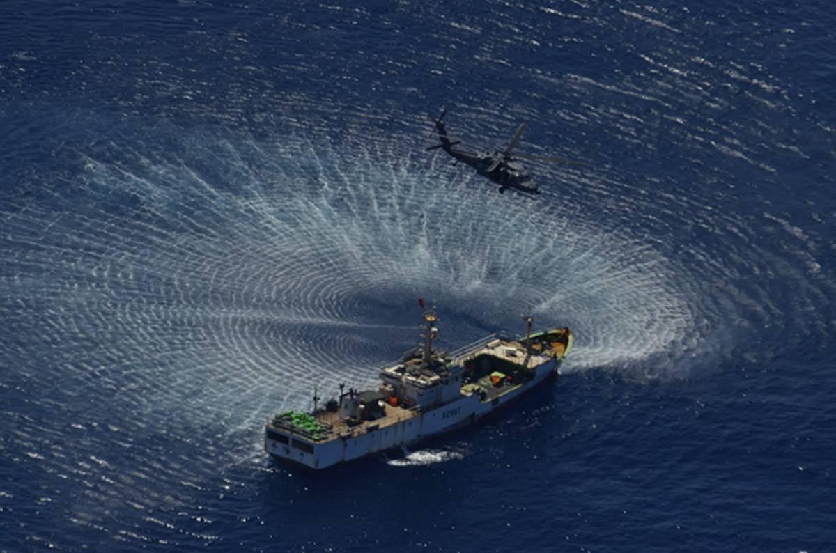 File An HH-60G Pave Hawk rescue helicopter from the 129th Rescue Wing hovers over the Chinese fishing vessel Fu Yua (Photo: California Air National Guard).