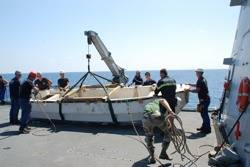 File Pirate Craft Hoisted on Board: Photo credit EUNAVFOR