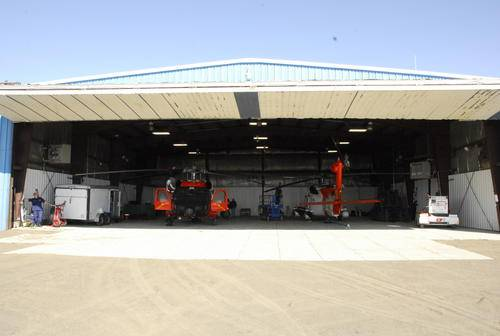 Two Kodiak-based MH-60 Jayhawk helicopters sit in a Barrow Airport hangar ready to respond to any maritime search and rescue emergency July 10, 2012.