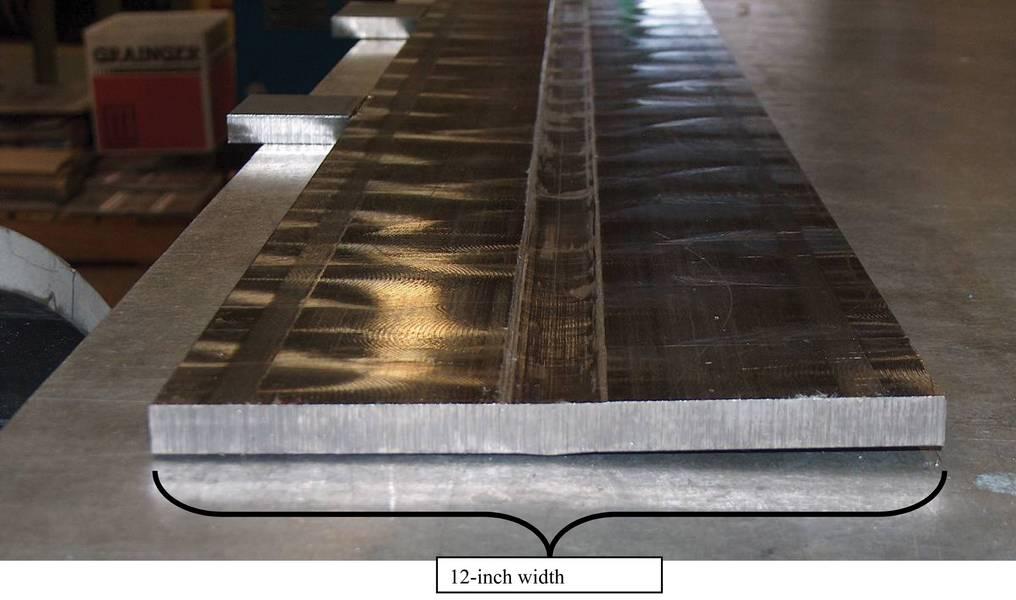 Figura 3 TSW completada de CP5 de 12 mm (1/5 pulg) de espesor de titanio. Tenga en cuenta la mínima distorsión térmica. Imagen: NASA