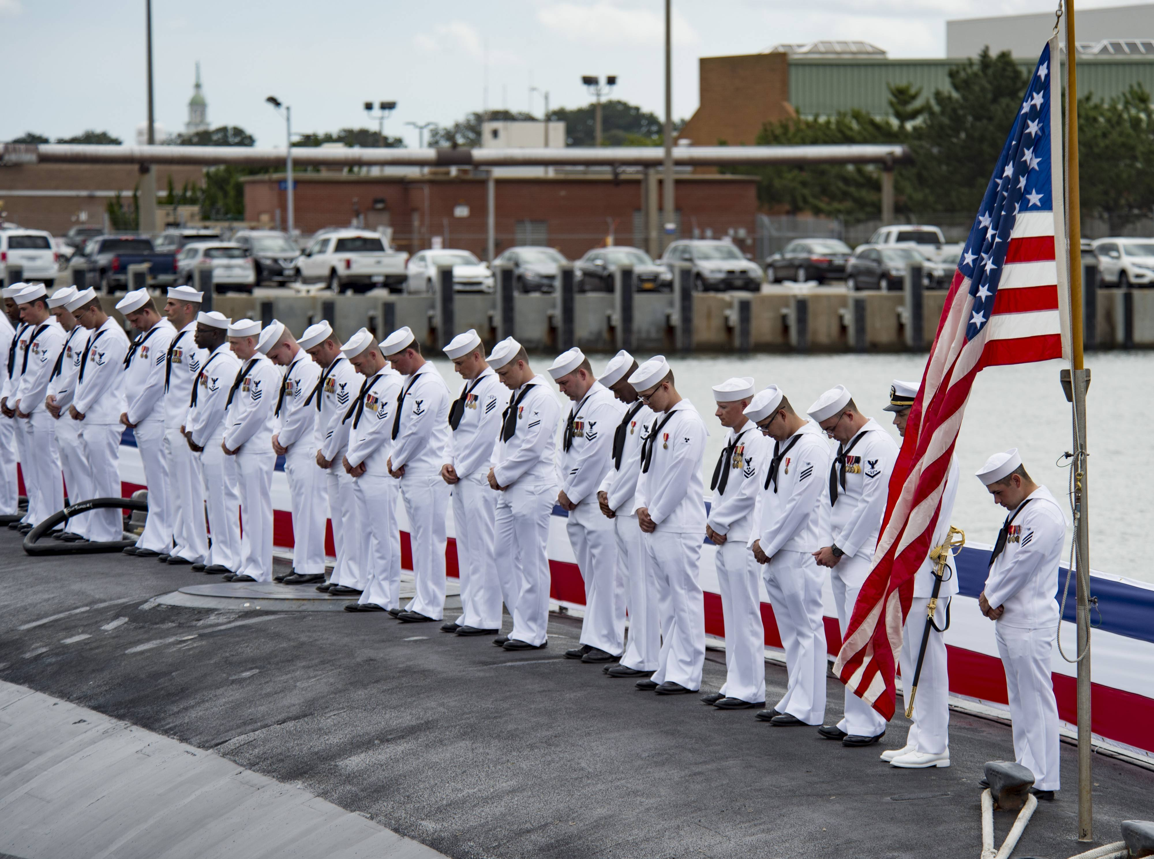 Sailors render a salute during the commissioning ceremony for the Virginia Class Submarine USS Washington at Naval Station Norfolk