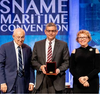"""HII President and CEO Mike Petters, center, accepts the 2019 Vice Admiral Emory S. """"Jerry"""" Land Medal from, at left, Fred Harris, former president of General Dynamics NASSCO and Bath Iron Works, and Suzanne Beckstoffer, president of Society of Naval Architect and Marine Engineers (SNAME). The Land Medal is presented to an individual for outstanding accomplishment in the marine field. Photo courtesy of SNAME"""