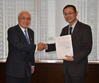 Paraguayan Ambassador to Japan Naoyuki Toyotoshi (left) presents MOL President Koichi Muto with a letter of thanks for the company's transport of used wheelchairs for disabled children in Paraguay.