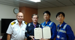 left to right, Capt. Kyaw Myint (SONGA HAWK master), Mijo Banicek (Songa Ship management electrical superintendent), Jeoung-kyu Lim and Sang-hoon Choi from KR's Cyber Certification Team.  (Photo: KR)