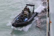 HMAS Melvilles Rigid Hull Inflatable Boat prepares to deliver emergency water supplies to Daydream Island as the ship supports the rescue of more than 400 people, following the destruction caused by Tropical Cyclone Debbie. Photo: Royal Australian Navy
