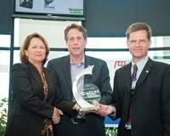 Johann Sigurjonsson and Scott Atkinson of Rapp Hydema receiving award at OTC