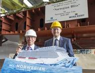Norwegian Cruise Line president and CEO Andy Stuart and MEYER WERFT managing partner Tim Meyer at the keel laying for Norwegian Bliss. (Photo: NCL