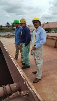 Chairman Cordero (R) observes vessel discharge operations.