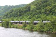 File Image: A typical Crude Oil train in the United states makes its way south along inalnd waterways. CREDIT: Dagmar Etkin