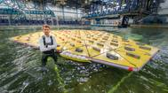 MARINs Olaf Waals pictured with the scale model of a mega floating island in its Offshore Basin in a storm of waves, wind and currents. (Images: MARIN)