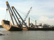 Inland Salvage Raises Scrap Metal Barge on the Mississippi River.