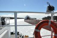 The Cutter Mackinaw comes ahead and creates a track through the ice for the motor vessel James R. Barker (which had become stuck in brash ice) to follow in the vicinity of the Johnson Point Turn in the lower St. Marys River. Photo: USCG