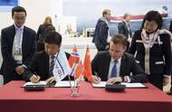 Front, from left to right: Gui Ming Zhu, Deputy General Manager of CMIH and Director of Yiu Lian Dockyards (Shekou) Limited; and Torgeir Sterri, Regional Manager Greater China at DNV GL – Maritime; sign a strategic cooperation agreement at Nor-Shipping this week. (Photo: DNV GL)