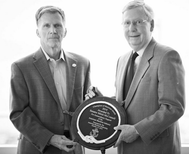 Stephen Little, President and CEO of Paducah, KY based Crounse Corporation presents the Champion of Maritime award to Senator Mitch McConnell, who noted the huge impact America's domestic maritime industry has in his home state of Kentucky.