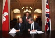 Left: Chan Fan, Frank, JP, Secretary for Transport & Housing, Hong Kong Government; right: Maritime London Chairman,  Lord Mountevans ; back: UK Minister of State for Transport Legislation and Maritime, John Hayes, CBE, MP. (Photo: Maritime London)
