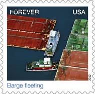 U.S. Postal Stamp: Barge Fleeting, an aerial view of towing vessels.