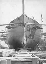 USS Intrepid Bow view, taken in dry dock, circa the 1870s. Note the torpedo projection device at her forefoot, pattern of her hull plating and the anchor hanging from her port hause pipe (U.S. Naval Historical Center Photograph.)