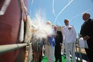 Sally Monsoor christens the future USS Michael Monsoor (DDG 1001), which is named in honor of her son, Medal of Honor recipient Navy Petty Officer 2nd Class (SEAL) Michael A. Monsoor. (U.S. Navy photo courtesy of Bath Iron Works)