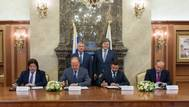 Signing, left to right: Andrey Shishkin, VP for Energy, Localization and Innovation of Rosneft; Sergey Khramagin, CEO of STLC; Oleg Tereschenko, CEO of Rosnefteflot; Sergey Frank, President and CEO of SCF Group. Standing in back, left to right: Igor Sechin, CEO and Chairman of the Management Board of Rosneft; Viktor Olersky, Deputy Minister of Transport of the Russian Federation, Head of the Federal Agency for Marine and River Transport (Rosmorrechflot)