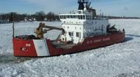 The Coast Guard Cutter Mackinaw, a 240-foot heavy icebreaker, breaks ice near Marine City, Mich., along the St. Clair River (Photo: Daniel R. Michelson / U.S. Coast Guard)