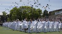 File photo: The cadets of the class of 2019 throws their covers into the air as they officially become ensigns during the 138th commencement exercises at the U.S. Coast Guard Academy in New London, Conn., May 22, 2019. (U.S. Coast Guard photo by Matthew Thieme)