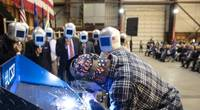 A welder authenticates the keel of LCS 27, the future USS Nantucket, by welding the initials of ship sponsor Polly Spencer. Pic: Lockheed Martin Nantucket