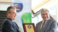 Left to right: Craig McLean of NOAA presents Fugro's Edward Saade with a commemorative plaque in formal commendation of the company's leadership in advancing global ocean mapping (Photo: Fugro)
