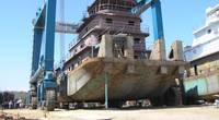 A steel tug built by Horizon Shipbuilding on the 660-ton Travelift at Metal Shark's newly-acquired Alabama Shipyard (Photo: Metal Shark)