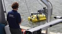 NOAA scientist operates an autonomous surface vehicle in the Port of Gulfport, Miss., during the Commander, Naval Meteorology and Oceanography Command's Advanced Naval Technology Exercise on Nov. 6, 2019, to test and evaluate new maritime technologies. (CNMOC)