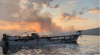 Photo of Conception's burned hull at dawn on September 2, 2019, prior to sinking. (Credit: Ventura County Fire Department via NTSB)