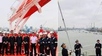 The crew gathers for the flag hoisting. Photos: Odfjell
