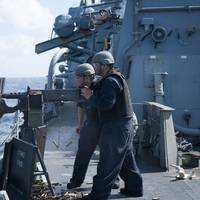 Sailors aboard Arleigh Burke-class guided-missile destroyer USS Curtis Wilbur (DDG 54) fire a M2HB .50-caliber machine gun during a gunnery exercise in the South China Sea. Curtis Wilbur is on patrol in the 7th Fleet area of responsibility in support of security and stability in the Indo-Asia-Pacific region. (U.S. Navy photo by Lt.j.g. Jonathan Peterson/Released)