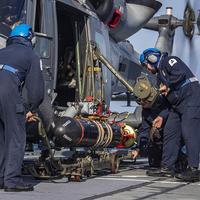 208 Flight load a TVT (dummy) onto a Wildcat HMA Mk2 (Photo: Royal Navy)