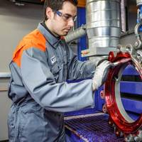A butterfly valve undergoing liquid penetrant inspection to check integrity of casting quality