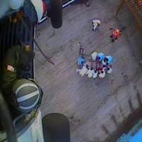 A Coast Guard helicopter crew hoists a 77-year-old woman suffering stroke symptoms, Monday, July 6. The crew took the ailing passenger to Vidant Medical Center in Greenville, North Carolina. (Screenshot from U.S. Coast Guard video by Air Station Elizabeth City)
