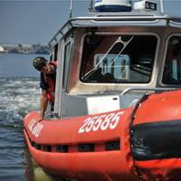 A crew from Coast Guard Station Curtis Bay, Md., trailers a 25-foot Response Boat-Small from the water to ensure its safety until the effects of Hurricane Earl are over in the upper Chesapeake Bay, Sept. 2, 2010. Prior to the hurricane impact, Coast Guard crews conducted harbor patrols to notify mariners of the possible danger and how to best prepare for it. U.S. Coast Guard photo by Petty Officer 2nd Class Brandyn Hill.