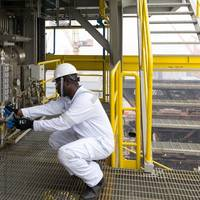 A DNV GL HazMat Expert doing a visual check for pipe gasket sampling. Photo DNV GL