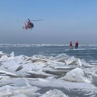 A helicopter from Coast Guard Air Station Detroit assists with the mass rescue of 46 people from an ice floe near Catawaba Island, March 9, 2019. 46 people were rescued by Coast Guard and local agencies after an ice floe broke free from land. (U.S. Coast Guard Photo)