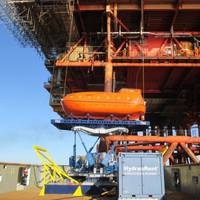 A lifeboat on the Ampelmann system right before installation (Photo courtesy of Ampelmann)