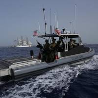 A patrol boat manned by members of Port Security Unit 311 deployed to Joint Task Force-Guantanamo Bay, Cuba, escorts the Coast Guard Cutter Eagle as it sails into Naval Base Guantanamo Bay, June 7, 2013. (U.S. Coast Guard photo by Petty Officer 2nd Class Steven Bolz)